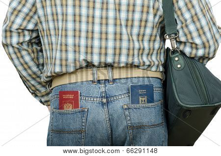 Passenger Holding Russian And Israeli Passports In Rear Pockets