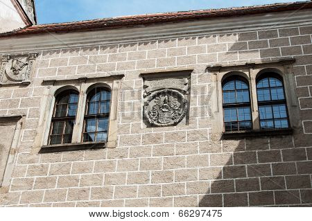 Windows and coat of arms founders castle in Telc