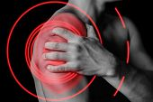 pic of muscle strain  - Unrecognizable man compresses his shoulder pain in the shoulder side view pain area of red color - JPG