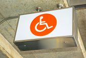stock photo of crippled  - label orange sign lightbox of cripple on concrete ceiling - JPG