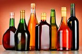 stock photo of ethanol  - Bottles of assorted alcoholic beverages including beer and wine - JPG