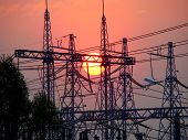 picture of substation  - Red Sun sets over the electrical substation - JPG