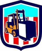 picture of forklift driver  - Illustration of a forklift truck and driver at work lifting handling box crate done in retro style inside shield crest shape - JPG