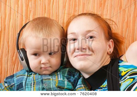 Mother With Son Listening To Music