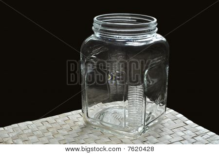 Wide mouth bottle on grass mat