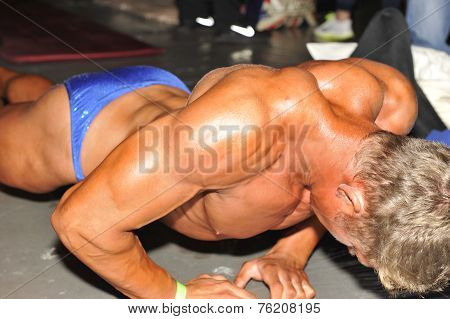 Male Bodybuilding Contestant Doing Warming Up Pushups