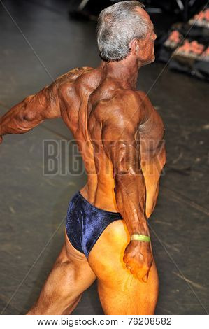 Male Bodybuilding Contestant Showing His Best Back Pose