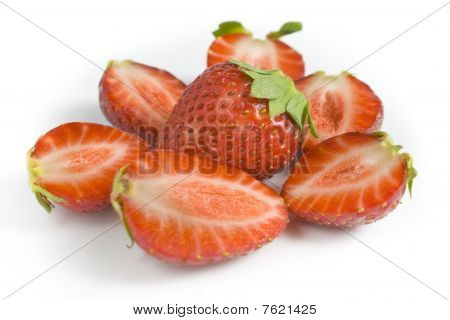 Whole Strawberry And The Berries Of A Strawberry Cut On Halves.