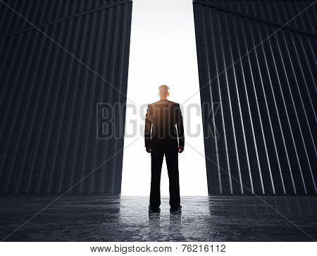 Businessman Looking To Doors