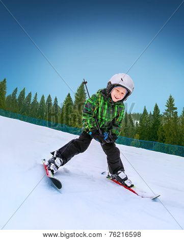 Little Skier Going Down From Snowy Hill