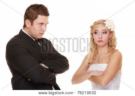 Bride And Groom Looking At Each Other Offended