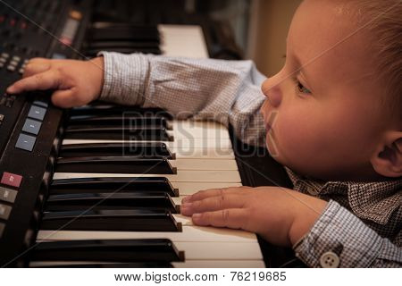 Boy Child Kid Playing On Digital Keyboard Piano Synthesizer
