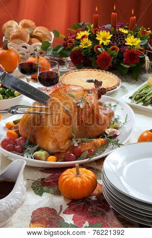 Carving Roasted Turkey On Harvest Table