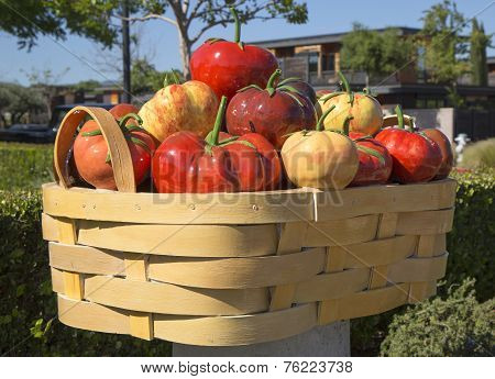 Abundance or tomato basket by Peter Hazel at art walk in Yountville, California