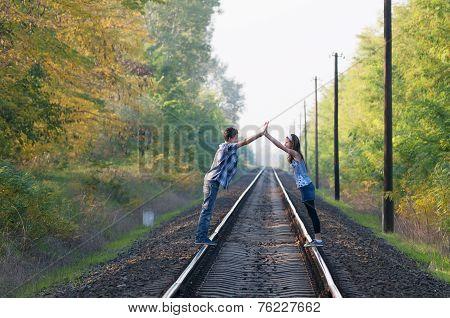Teen Girl And Boy Posing On Rails