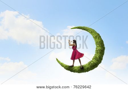 Young woman in red dress playing flute