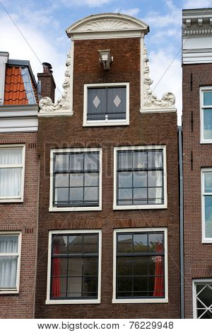 Typical merchant house facade in Amsterdam, Netherlands.