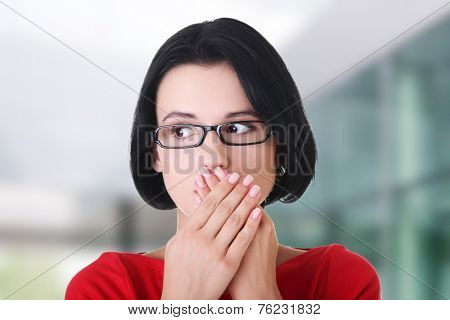 Shocked woman covering her mouth with hands.