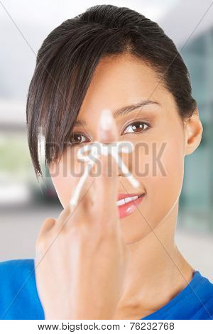 Woman trying to remember by a string on her finger