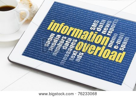 information overload concept - a word cloud on a digital tablet with a cup of coffee