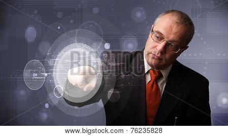Elegant businessman touching abstract high technology circular buttons