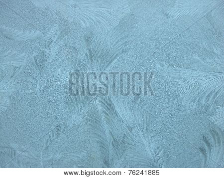 The frost has formed this beautiful pattern on a glass pane. It looks like feathers.