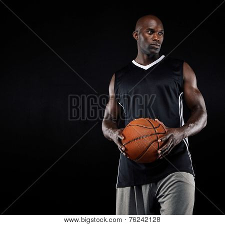 Black Basketball Player With Ball Looking Away
