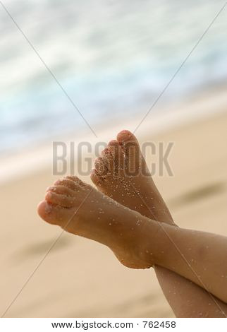 child feet in the air