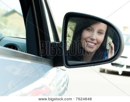 Brunette Teen Girl Sitting In Her Car Holding Keys