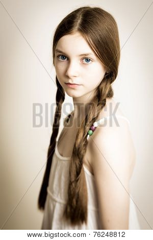 Ginger Girl With Blue Eyes And Plaits