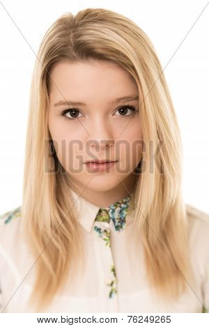 Blond Girl With Brown Eyes Looking Serious Against A White Back Ground