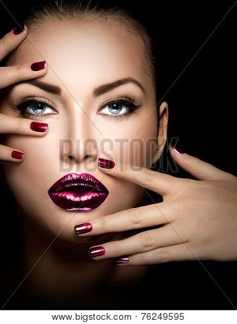 Fashion model girl face, beauty woman make up and manicure. Makeup closeup, perfect skin, manicured nails, deep violet color. Smoky eyes holiday luxury make-up, blue eyes