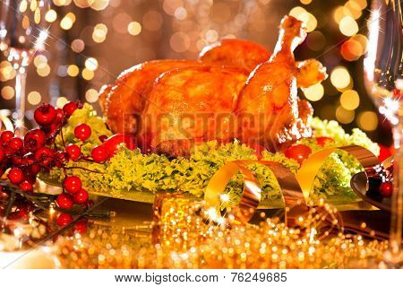 Christmas table setting with turkey. Christmas dinner. Holiday decorated table, Christmas tree, champagne and roasted turkey, Christmas served table