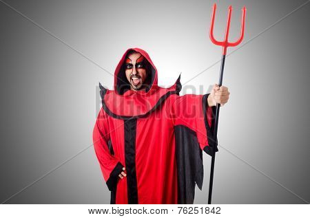 Man devil in red costume