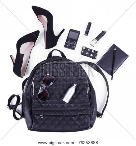 Female bag, shoes and accessories isolated on white