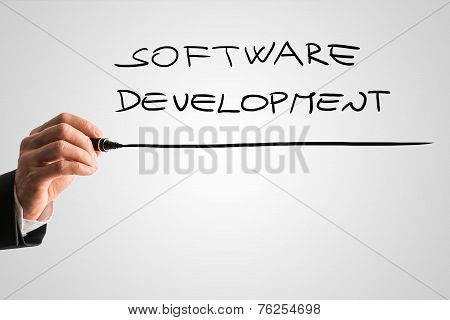 Hand Of A Man Writing Software Development On A Virtual Screen