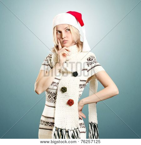 Woman with Santa's hat waiting for Christmas, make a wish, looking up