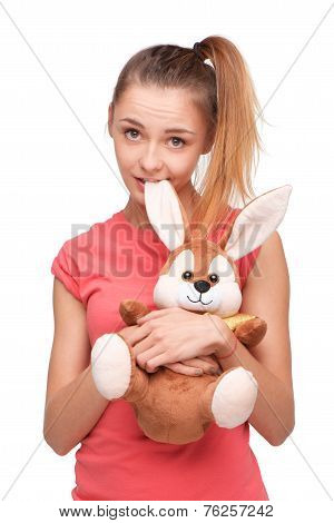 Teen girl with bunny toy