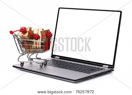 Laptop with shopping cart full of christmas or gift boxes isolated on white background with blank screen for copy