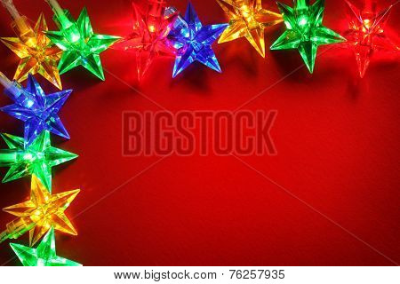 Christmas lights red background with copy space