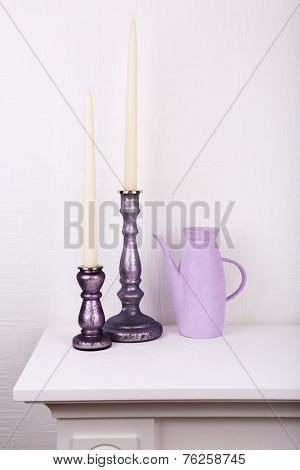 White candles in candle holders on white background