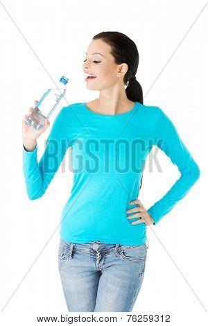 Portrait of a woman drinking water.