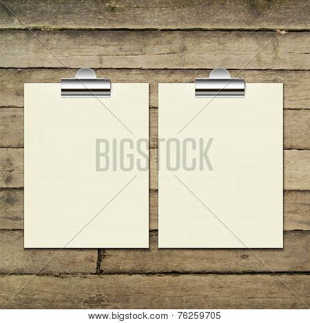 Vector template of a paper sheet on the wooden table.