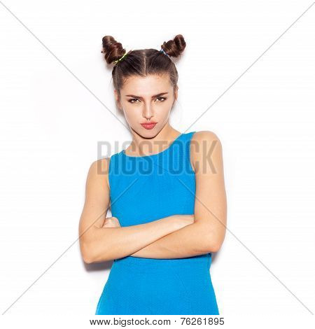 Woman With Serious Face Looking At The Camera