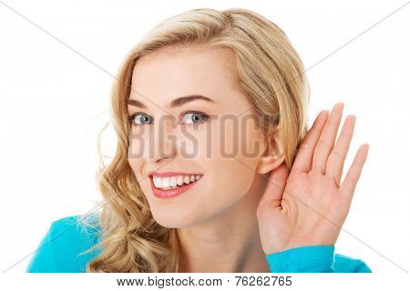 Portrait of woman overhearing a conversation.
