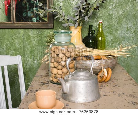 country kitchen with green walls and wood table, rural look