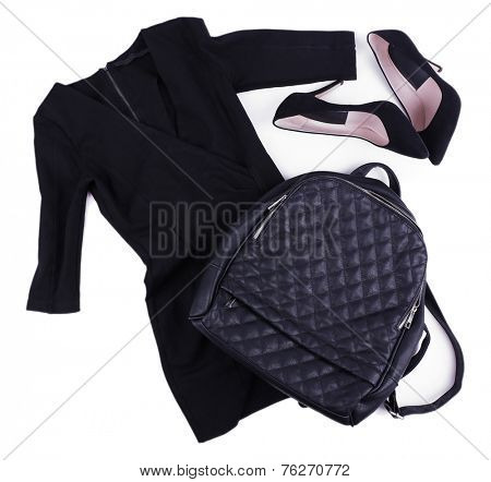 Female bag, dress and shoes isolated on white