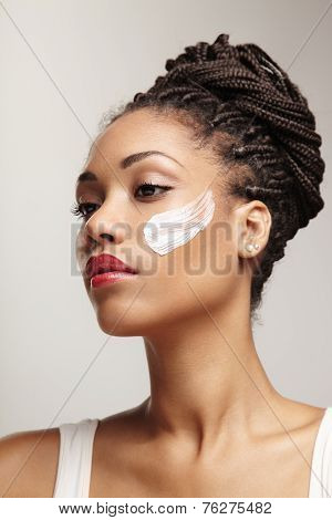 Beauty Black Woman With A Cream On Her Cheek