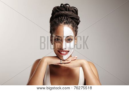 Beauty Latin Woman With A Half Of A Face Mask