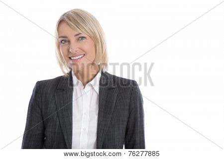 Portrait: Successful isolated older or mature blond businesswoman in blazer and white blouse.